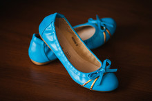Pair Of Blue Leather Ballet Flats On Wooden Background