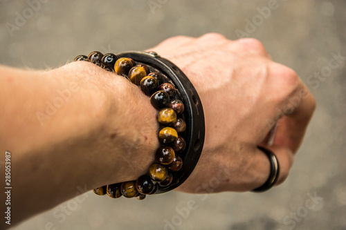 Cuadros en Lienzo Beaded bracelets and leather bracelet on a wrist with a tungsten ring on the thu