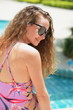Beautiful woman dressed in a swimsuit at the pool.