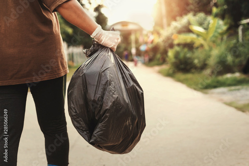 woman hand holding garbage bag for recycle putting in to trash Canvas