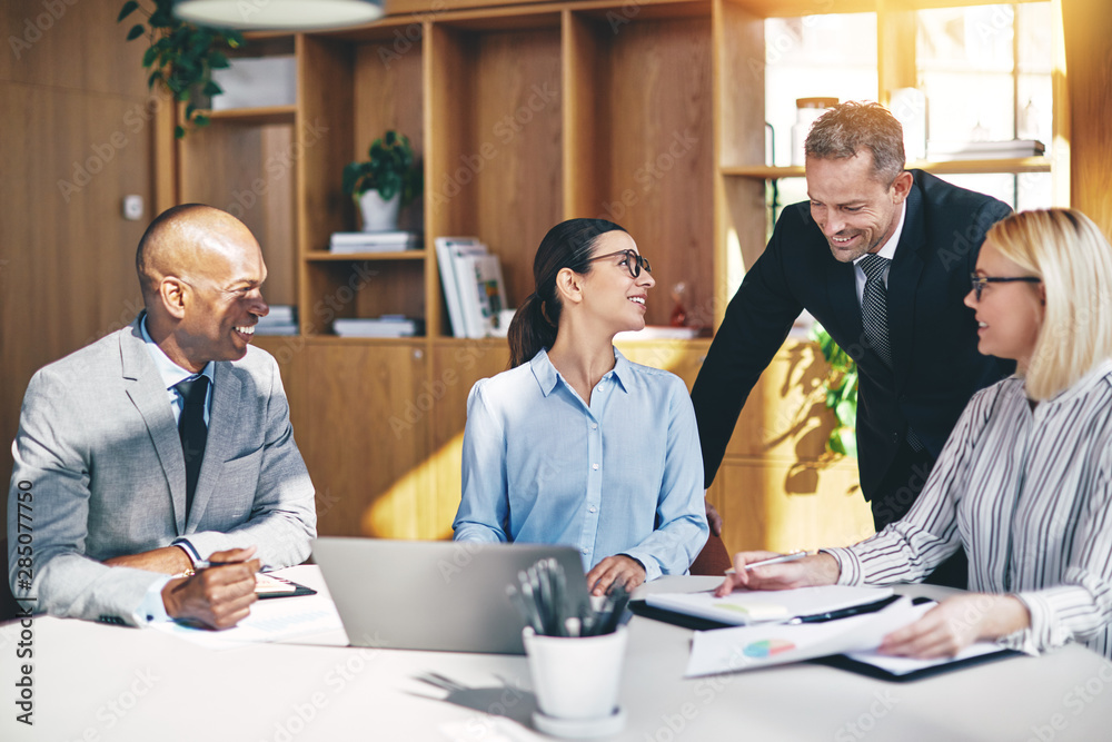 Fototapety, obrazy: Diverse businesspeople laughing together during an office meetin