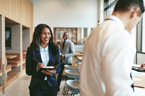 canvas print motiv - Flamingo Images : African American businesswoman laughing after a meeting with off