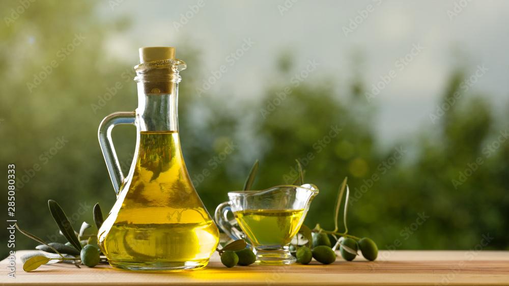Fototapety, obrazy: Olive oil bottle on wooden table, natural oils concept