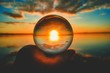 Creative crystal lens ball photography of the sunset with clouds blurred in the background