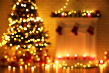 Blurred Background Of Decorated Fireplace Near Christmas Tree