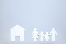 Paper Family Figures And House On Grey Background