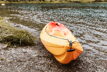 Yellow Kayak By The Shore Of A Lake