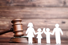 Family Figures With Gavel On B...