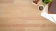 canvas print picture - Above table with notebook paper, pencil and coffee on wooden desk with top view.