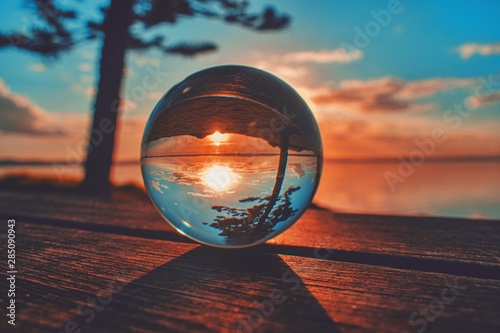 Fotografie, Obraz  Creative crystal lens ball photography of the beautiful sunset at a lake