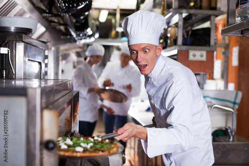 canvas print motiv - JackF : Happy surprised chef getting pizza out of oven