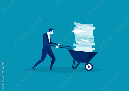 Fotografía  Businessman pushing  a wheelbarrow full of paper