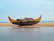 Leinwanddruck Bild - traditional Indian fisherman boat on a golden sandy beach at dawn