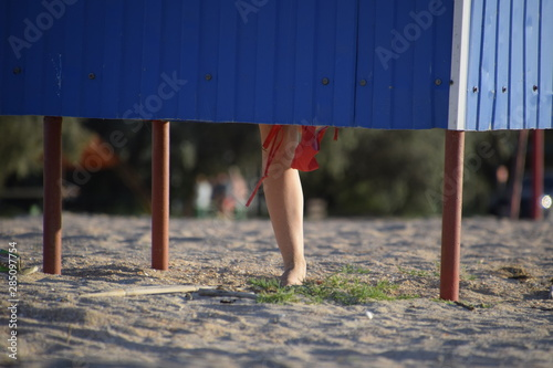 Fotografie, Obraz  Dressing room on the beach, girl's legs are visible from the dressing room