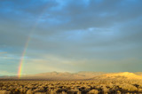 Fototapeta Tęcza - USA, Nevada, Churchill County, Dixie Valley: A rainbow curvers over the Louderback Mountains, Clan Alpine Range, and sunlit Chalk Mountain