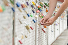 Germany, Bavaria, Munich, Man Locking Love Lock