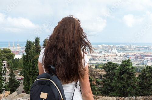 Young woman posing on a background of the landscape of Barcelona. Wallpaper Mural