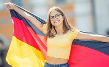Attractive Happy Young Girl With The Germany Flag