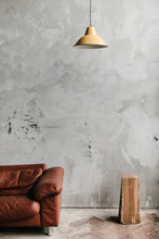 Sofa And Wood At Concrete Wall