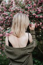Woman In Dress Under Blooming Tree