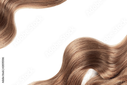 Natural brown hair isolated on white. Background, copy space