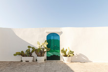 White Wall With Coloured Door ...