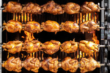 Street Food: Chicken Being Grilled On Large Grill