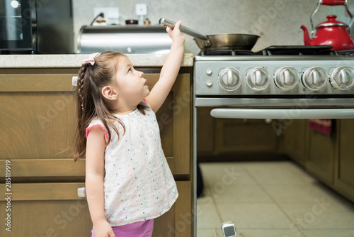 Fotografía  Female Toddler Learning Chores In Kitchen At Home