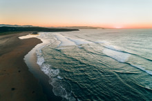 Aerial View Of A Wild Beach At Sunset