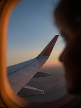 A Girl Looks In The Airplane W...