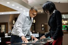 Jewelry: Salesperson Helps Man Look At Rings