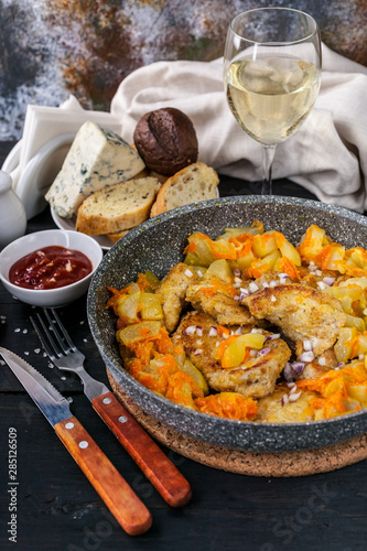 Chicken meat with stewed curry with vegetables in a pan, cheese, bread and white wine Wallpaper Mural