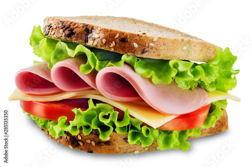 Keuken foto achterwand Snack Sandwich with whole grain bread, salad, cheese, tomato and ham on a white isolated background