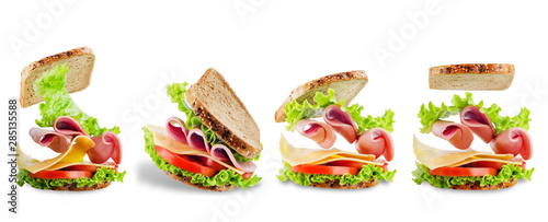 Foto op Plexiglas Snack Sandwich with whole grain bread, salad, cheese, tomato and ham on a white isolated background