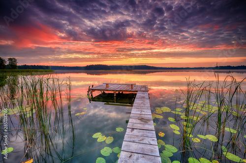 Photo sur Toile Aubergine Beautiful summer sunrise over lake