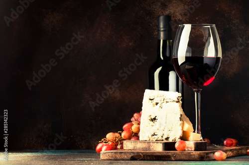 Port wine and blue cheese, still life in rustic style, vintage wooden table background, selective focus - 285142323