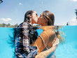 canvas print picture - Two lesbian women having fun in swimming pool one summer afternoon