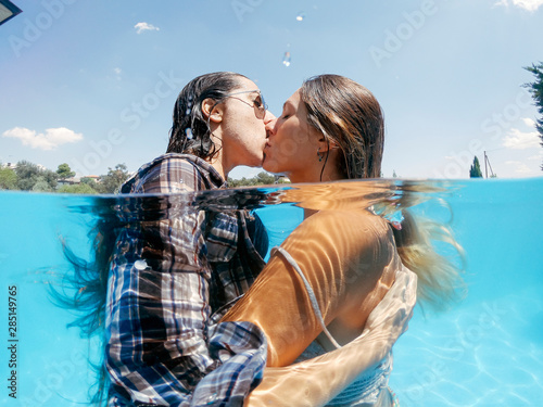 Photo  Two lesbian women having fun in swimming pool one summer afternoon