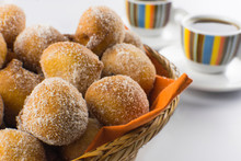 Traditional Brazilian Mini Fried Cakes Called Bolinho De Chuva In A Basket In White Breakfast Table Background Close