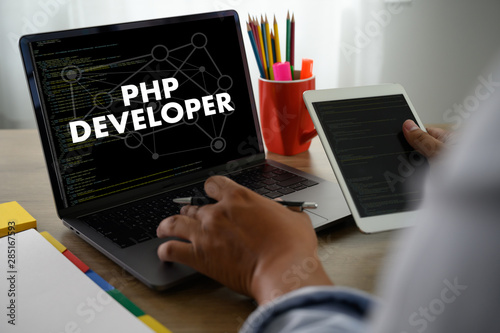 PHP DEVELOPER man touch bar search and Two Businessman working at office desk and using a digital touch screen tablet and use computer, top view Wallpaper Mural