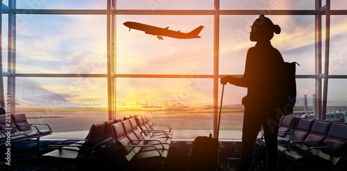 Silhouettes passenger airport. Airline travel concept... Wallpaper Mural