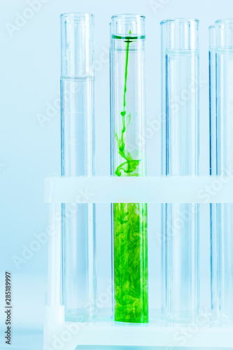 Poster Vegetal Green liquids in test tubes in chemical laboratory close up