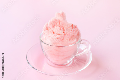 Fotografie, Obraz  Glass cup with tasty cotton candy on color background