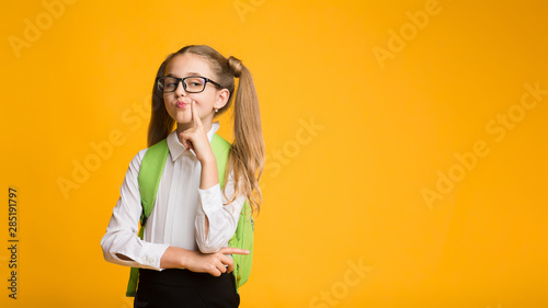 Obraz Funny Schoolgirl Posing Being Haughty On Yellow Background - fototapety do salonu