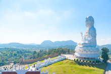 Big White Bodhisattva Guanyin Statue With Blue Sky Background At Wat Huai Pla Kung Temple, Chiang Rai,Thailand.Asian Landscape Famous Landmark.Religion Buddha Praying Fortune, Wealth, Money Concept