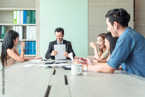 Fototapety, obrazy: Teamwork business concept .Start up business people in modern office, working together having success. Multiethnic start-up business team on meeting in modern bright office interior brainstorming