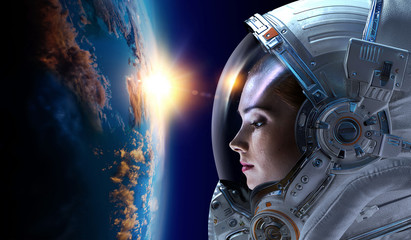 Astronaut and planet, human in space concept