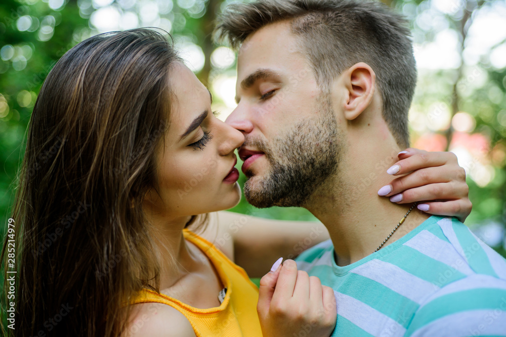 Fototapeta Passionate kiss concept. Giving kiss. Seduction and foreplay. Sensual kiss of lovely couple close up. Couple in love kissing with passion outdoors. Man and woman attractive lovers romantic kiss