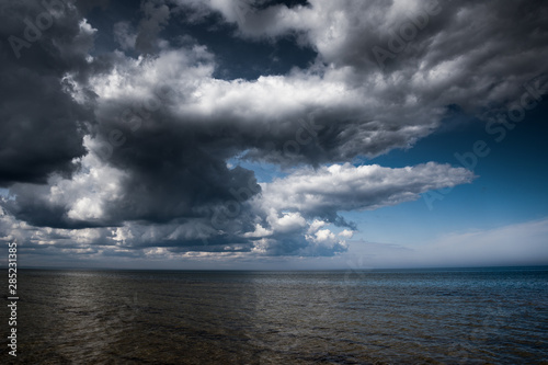 Foto auf Leinwand Blaue Nacht Cloudy day by gulf of Riga, Baltic sea.