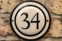 Door Number 34 Thirty Four Conceptual Image Closeup